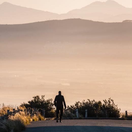 man walking road
